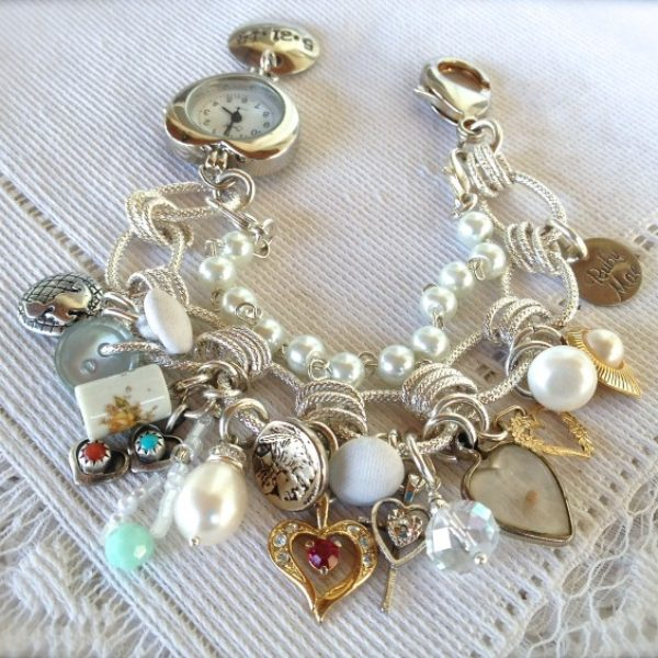 This bridal bracelet was for a daughter in law Alicia. Her mom in law Belinda gathered treasures from family members and each item has significance.