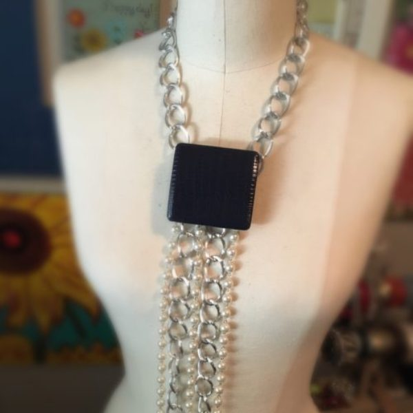 One-of-a-kind silver and blue sparkle body necklace was inspired by the Dallas Cowboys.
